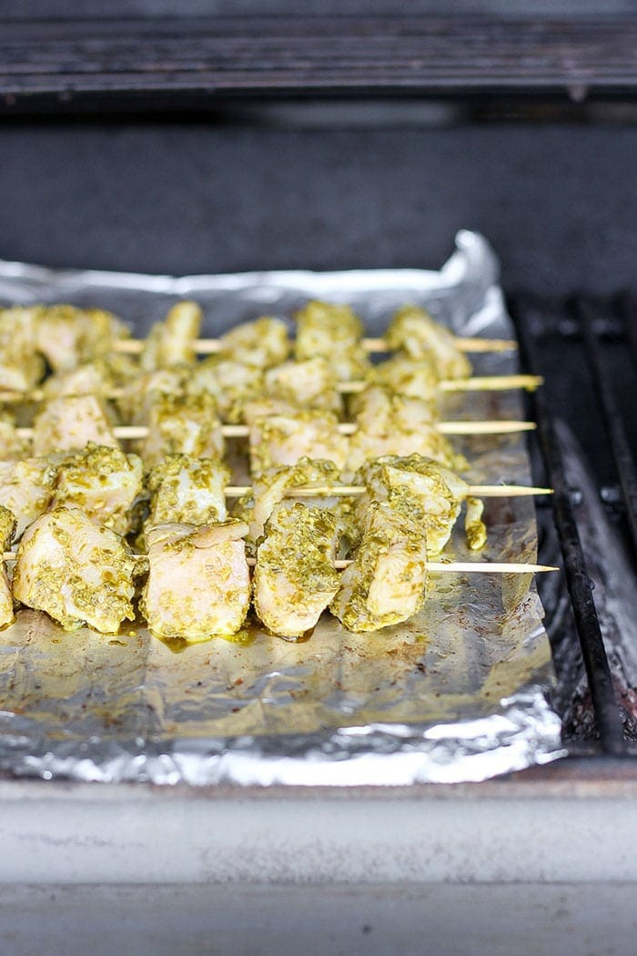 chicken skewers on a grill