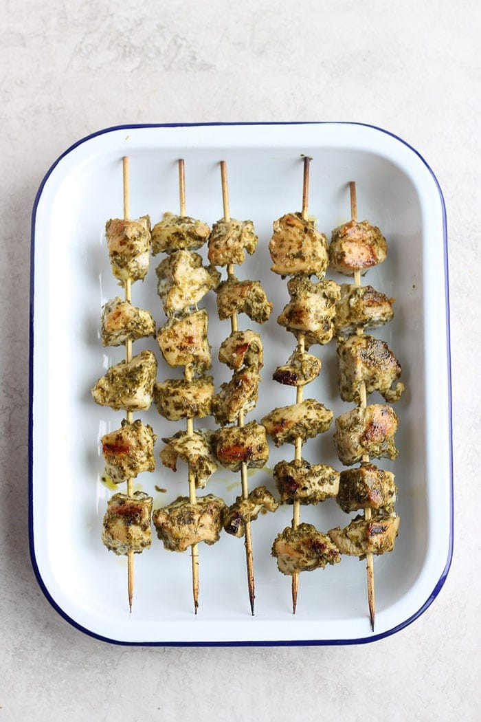 grilled chicken skewers in a tray