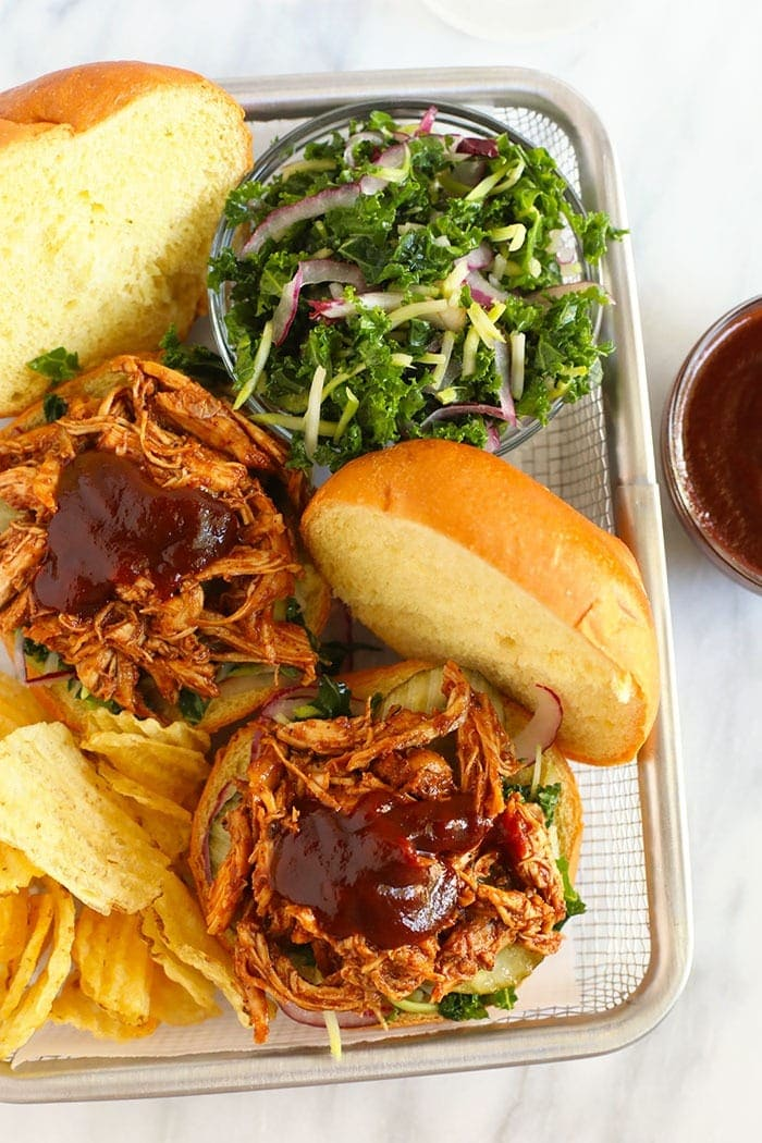 pulled chicken on bun with bbq sauce