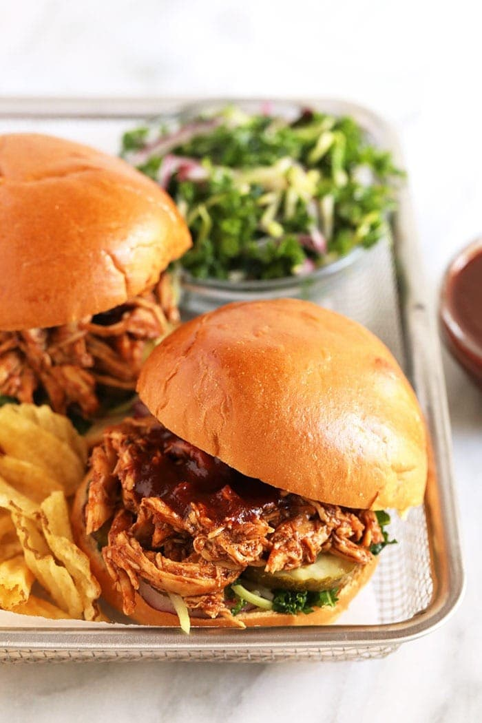pulled bbq chicken on bun with chips