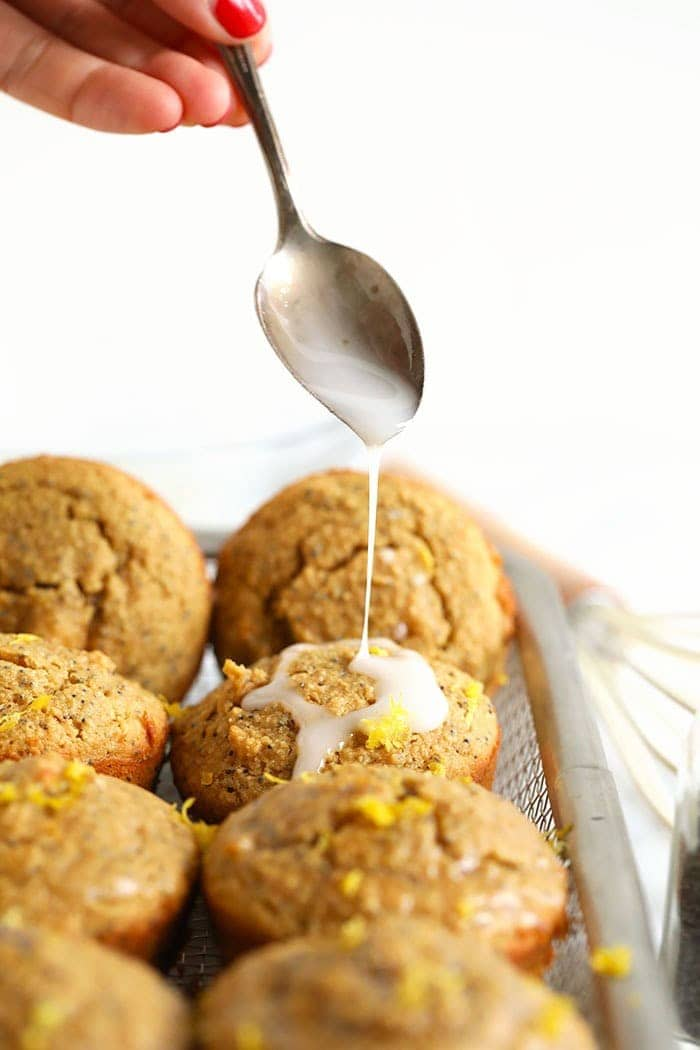 Drizzling icing onto lemon poppy seed muffins