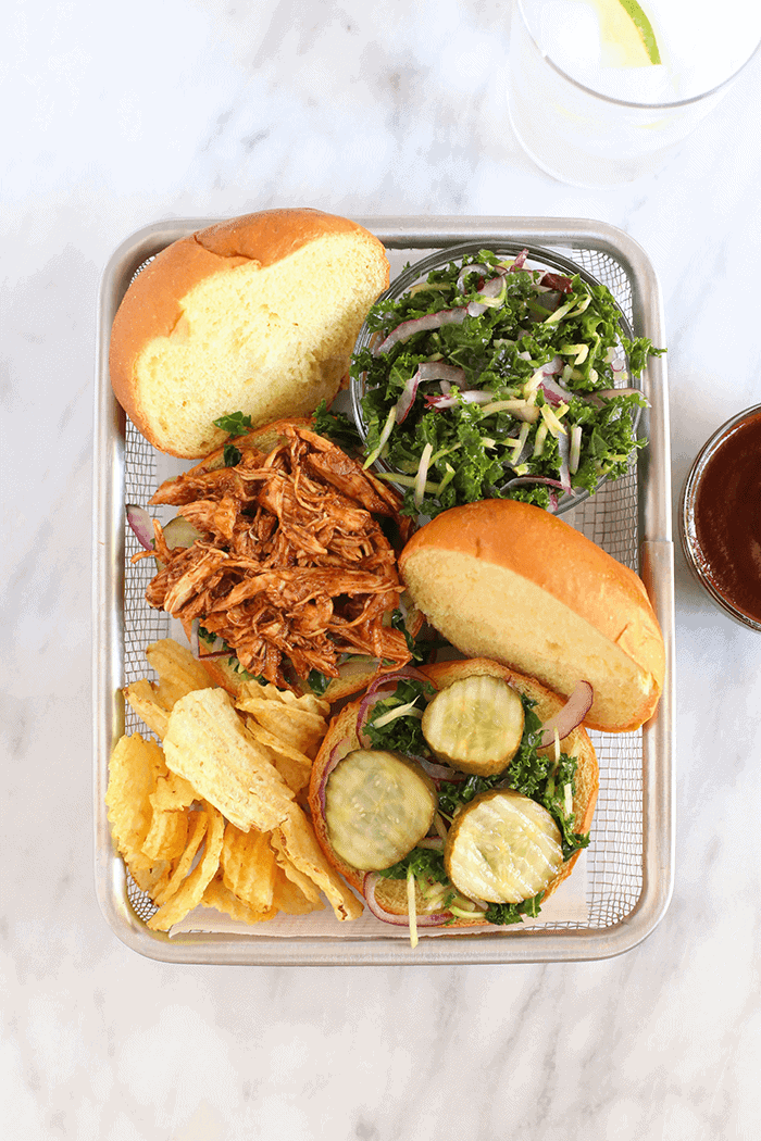 slow cooker bbq pulled chicken in basket with chips and slaw