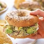 avocado tuna salad sandwich on a bagel