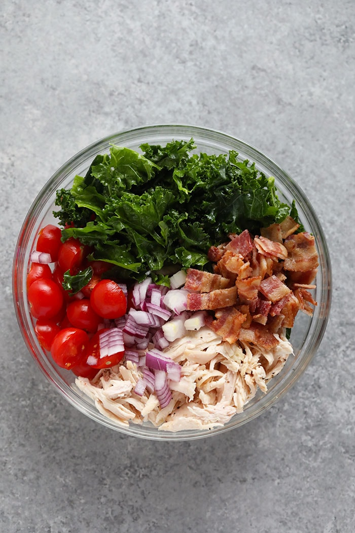 healthy BLT chicken salad ingredients in a bowl