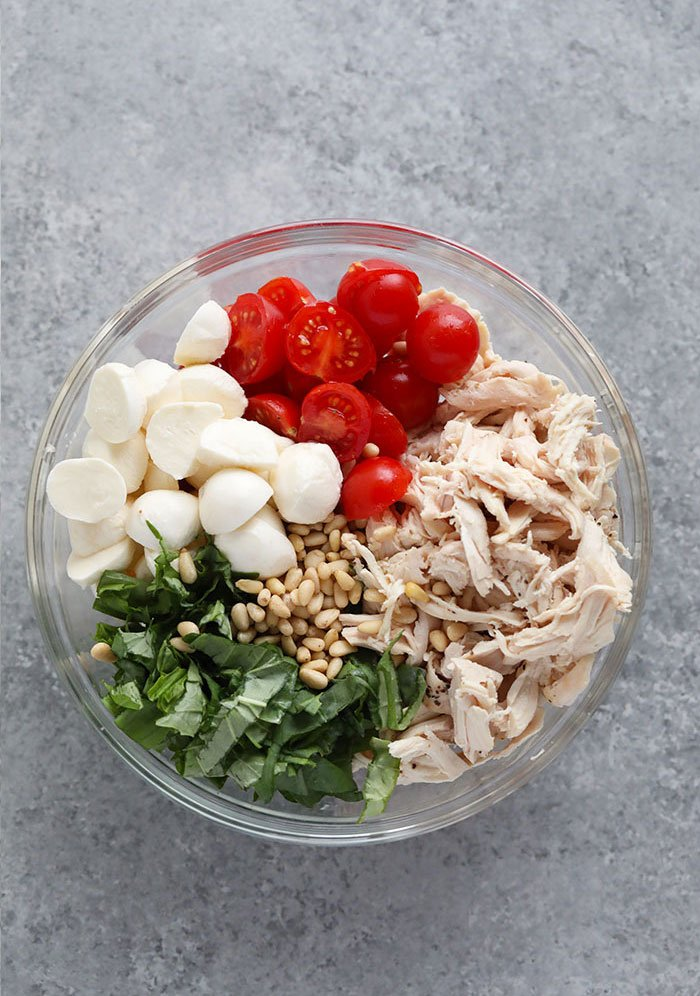 Ingredients for the pesto chicken salad in a bowl.