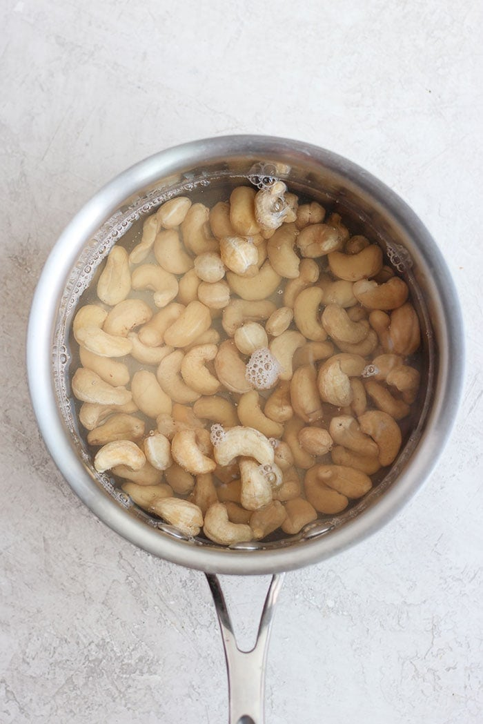 cashews in a sauce pan ready to be flash boiled