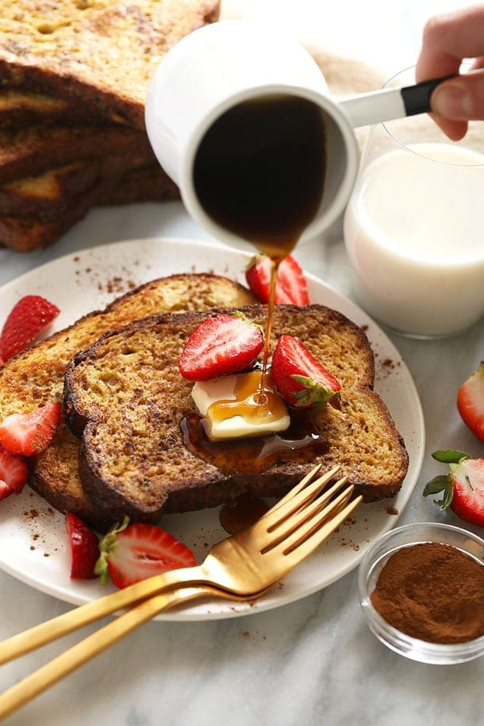 sheet pan french toast on a plate drizzled with maple syrup