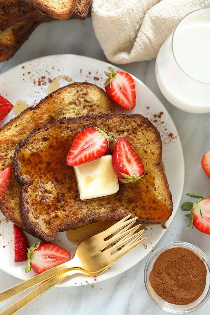 sheet pan french toast on a plate with strawberries