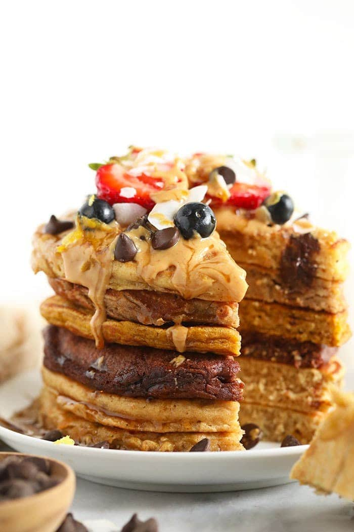 a stack of pancakes with topings!