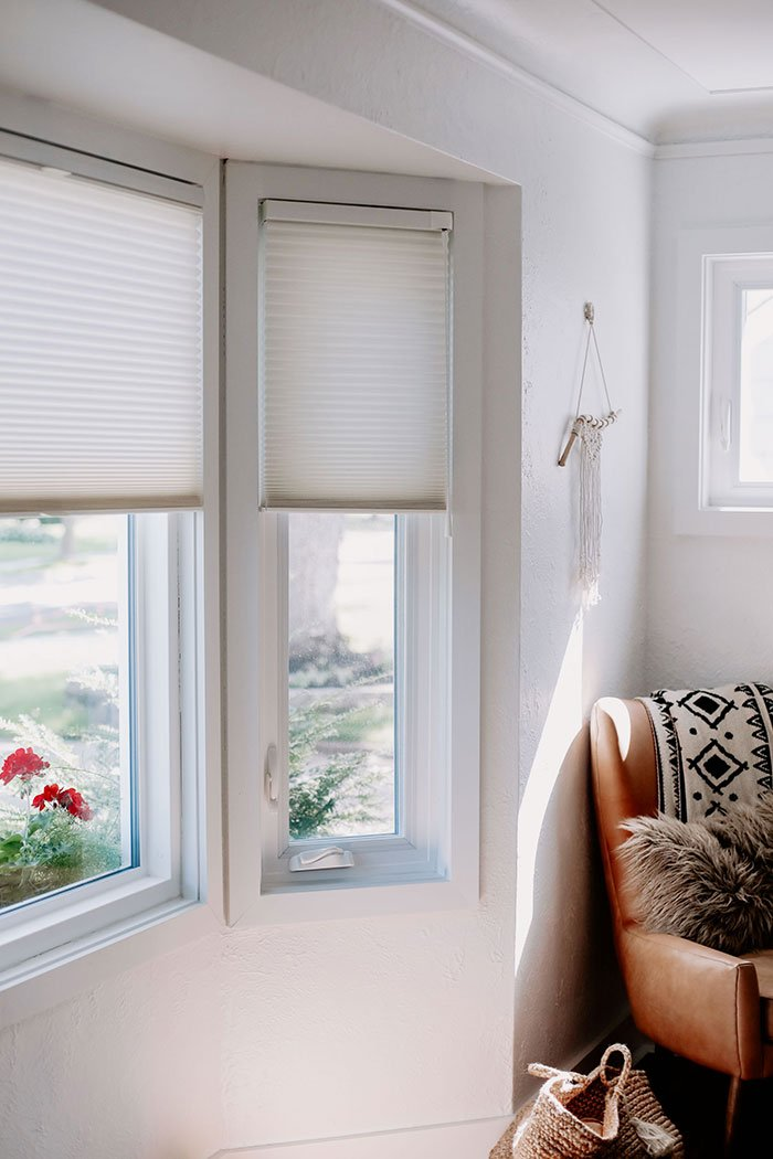 white custom hunter douglas blinds in window