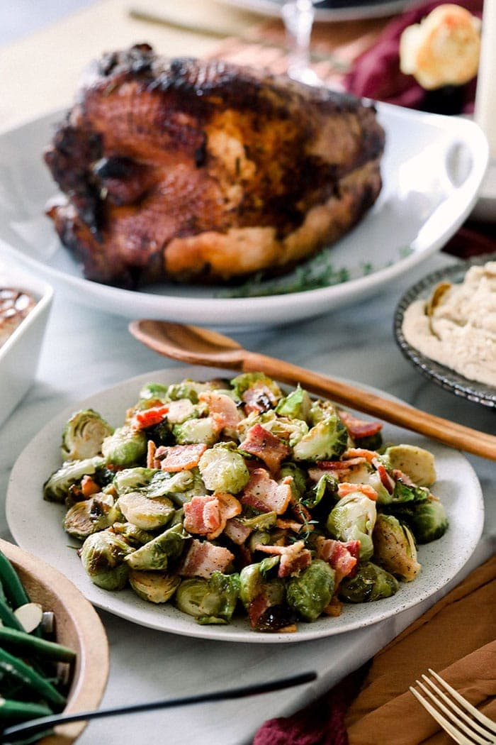 roasted brussels sprouts in bowl on table with turkey