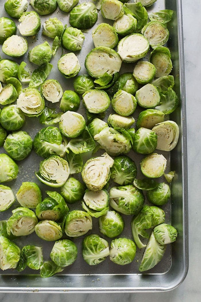 sliced brussels sprouts on sheet pan