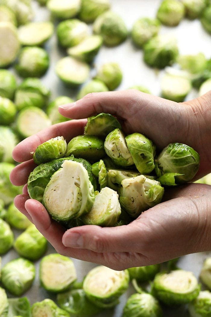 brussels sprouts in hands