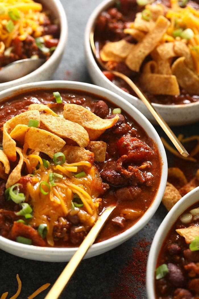 bowl of beef chili with Fritos and shredded cheese