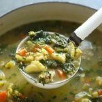 Chicken noodle soup in a ladle