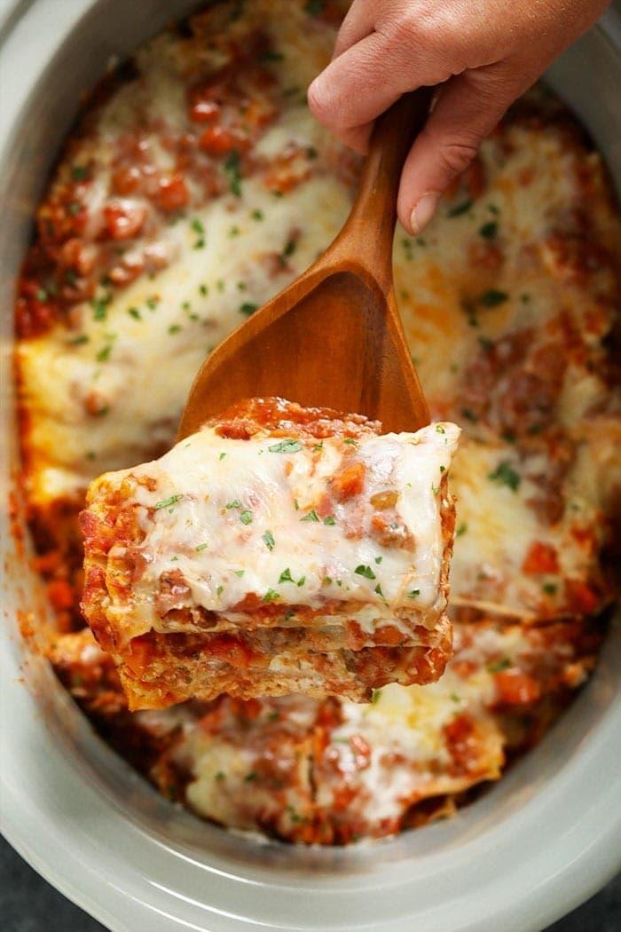 Piece of crockpot lasagna on a spatula