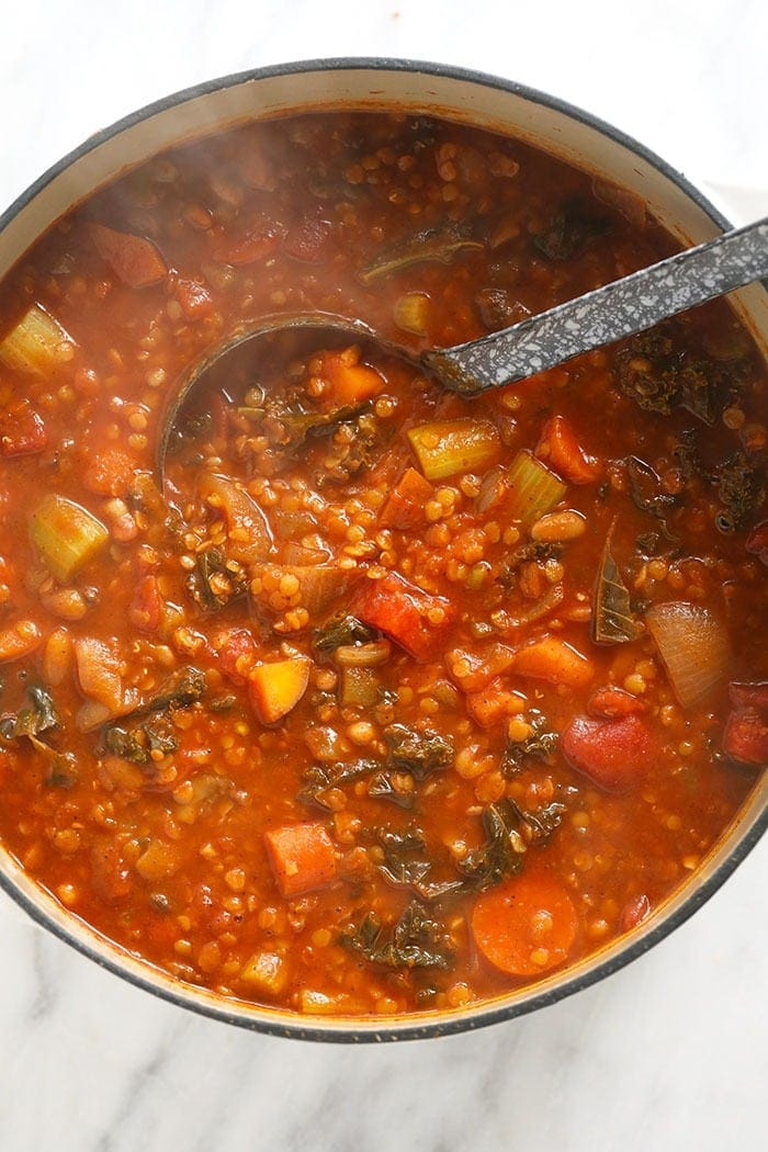 Finished lentil stew ready to eat with a ladle in it!