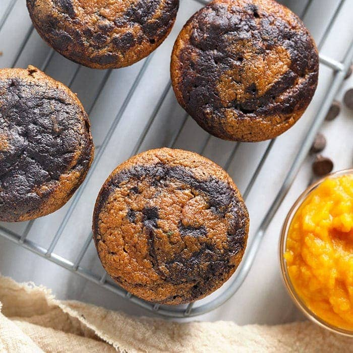 chocolate pumpkin zucchini muffins on a cooling rack