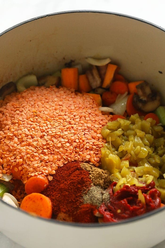 All the ingredients for lentil stew in a pot.
