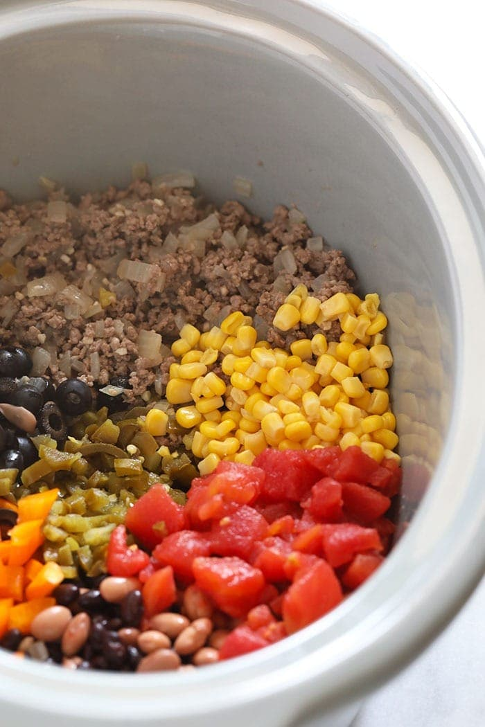 slow cooker taco soup ingredients in a slow cooker