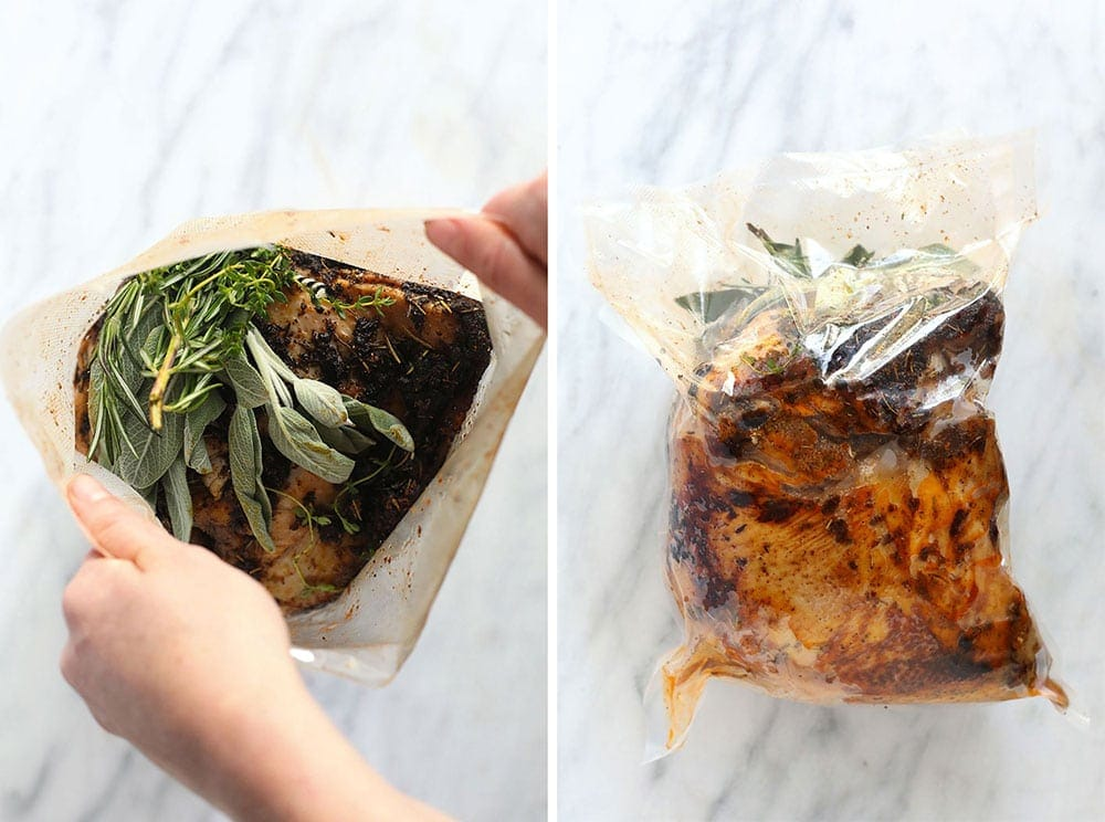 Sous vide turkey in a bag with fresh herbs.