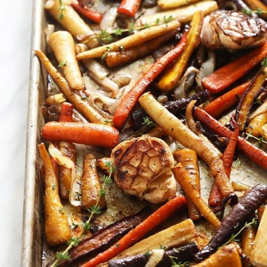 roasted carrots and garlic on a baking tray