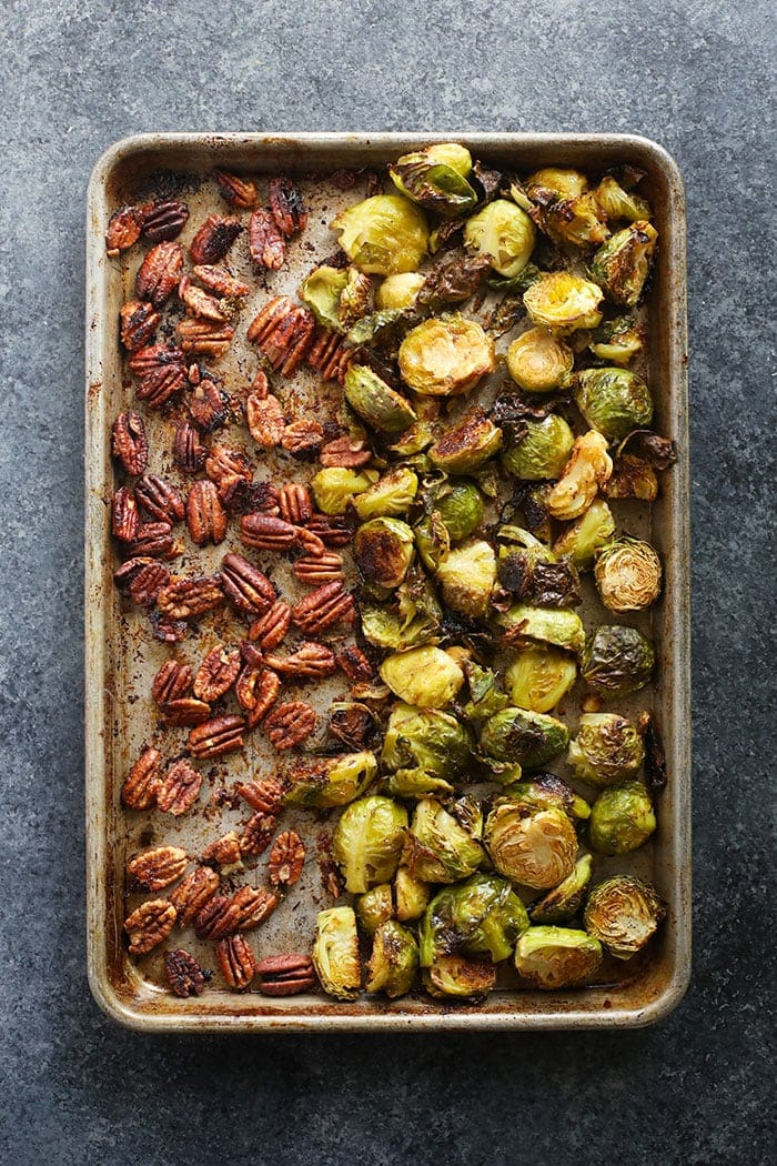 Brussel sprouts and pecans baked and ready to eat on a baking sheet