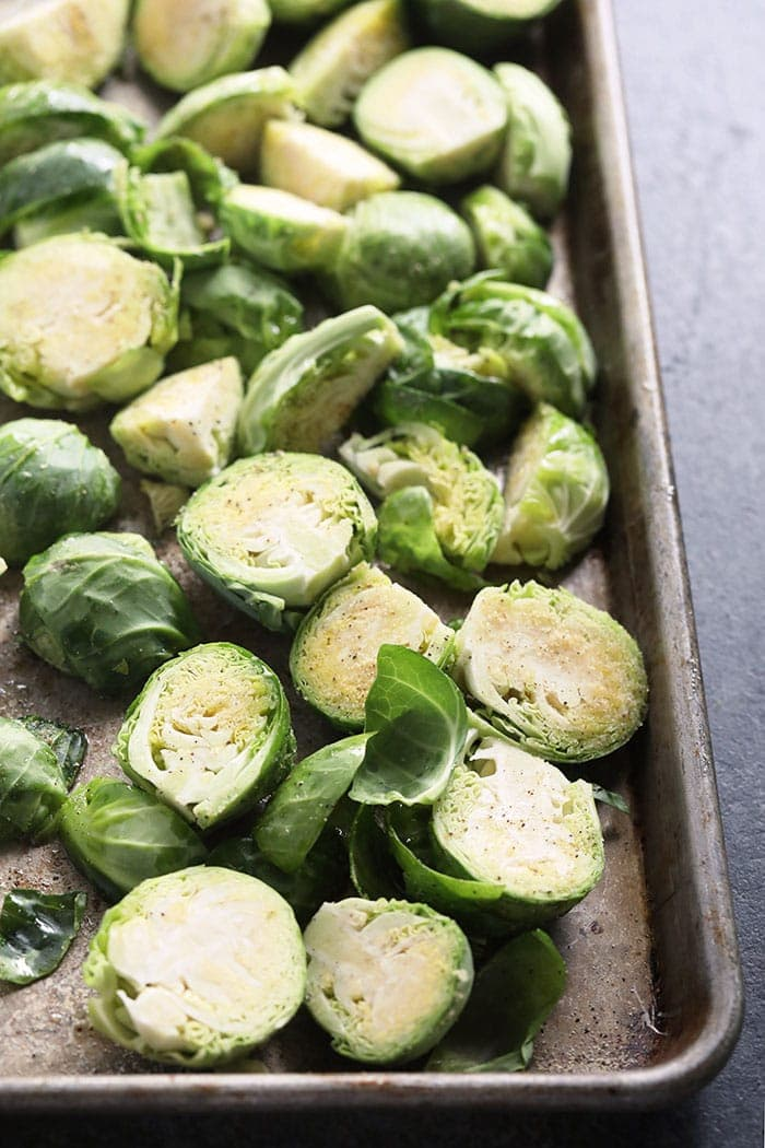 Fresh brussel sprouts on a baking sheet