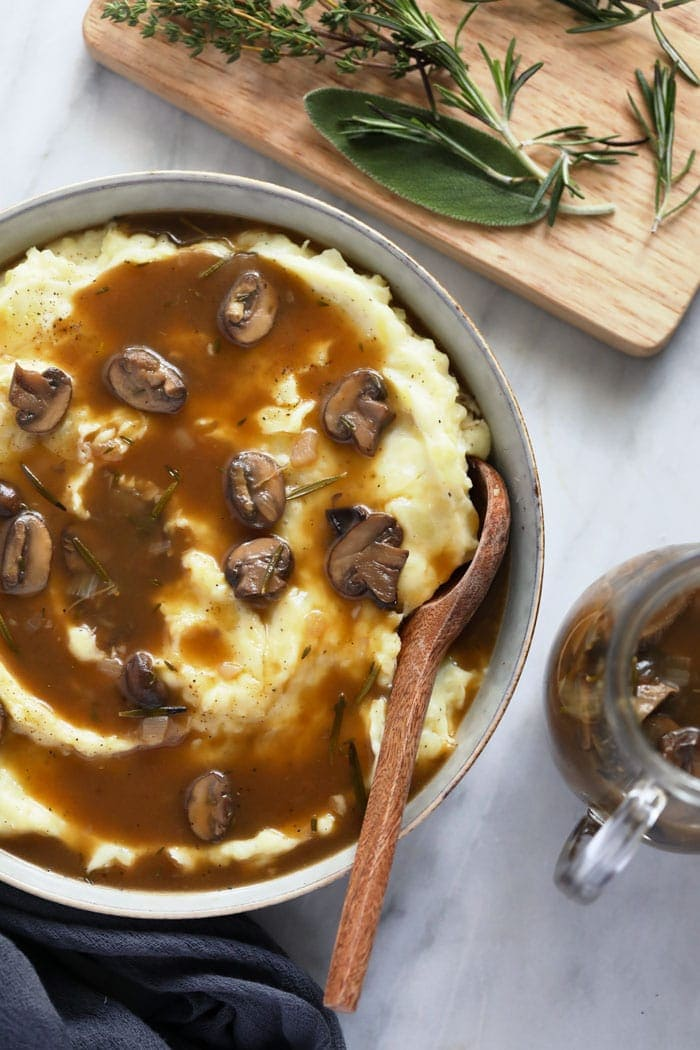 Mushroom gravy over mashed potatoes in a bowl