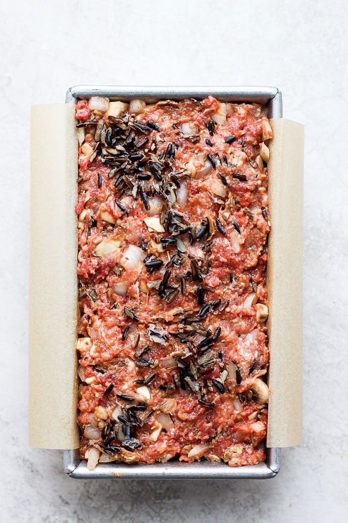 wild rice meatloaf in a loaf pan ready to be baked