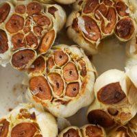 roasted garlic cloves in a baking dish