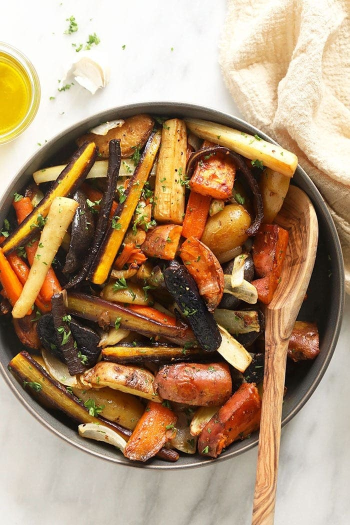 roasted root veggies in bowl with spoon