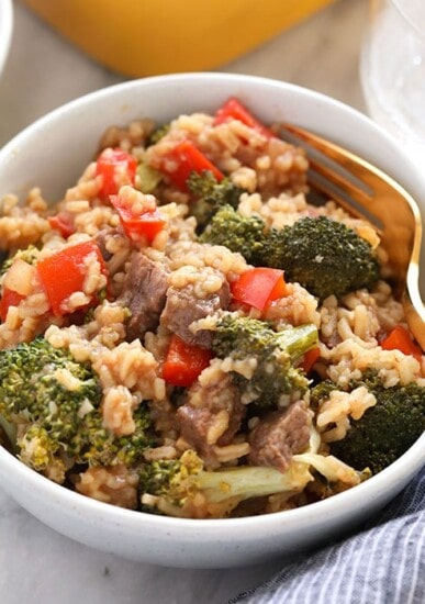 beef and broccoli with rice in dish