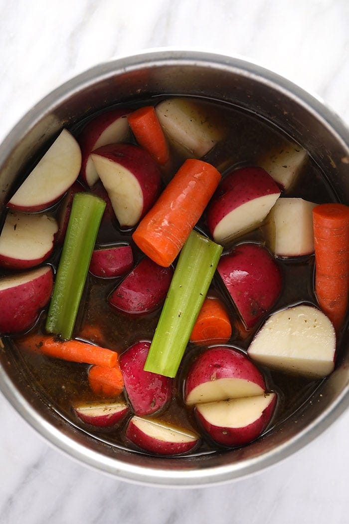 pot roast veggies in the instant pot ready to be pressure cooked