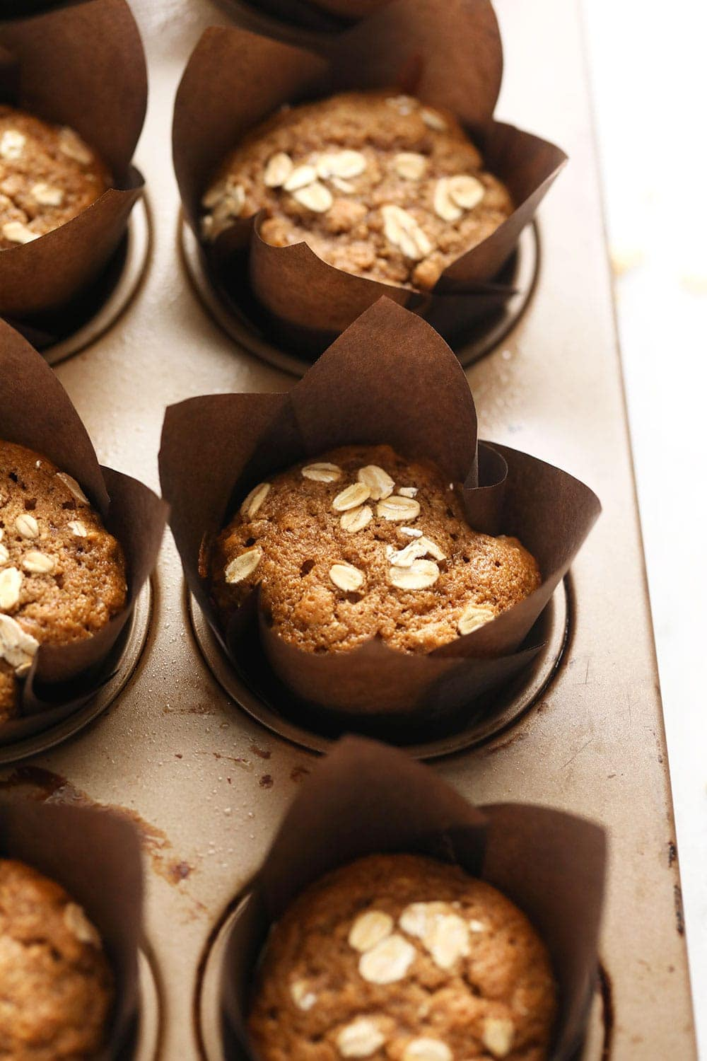 classic oatmeal muffins in a muffin pan after baking
