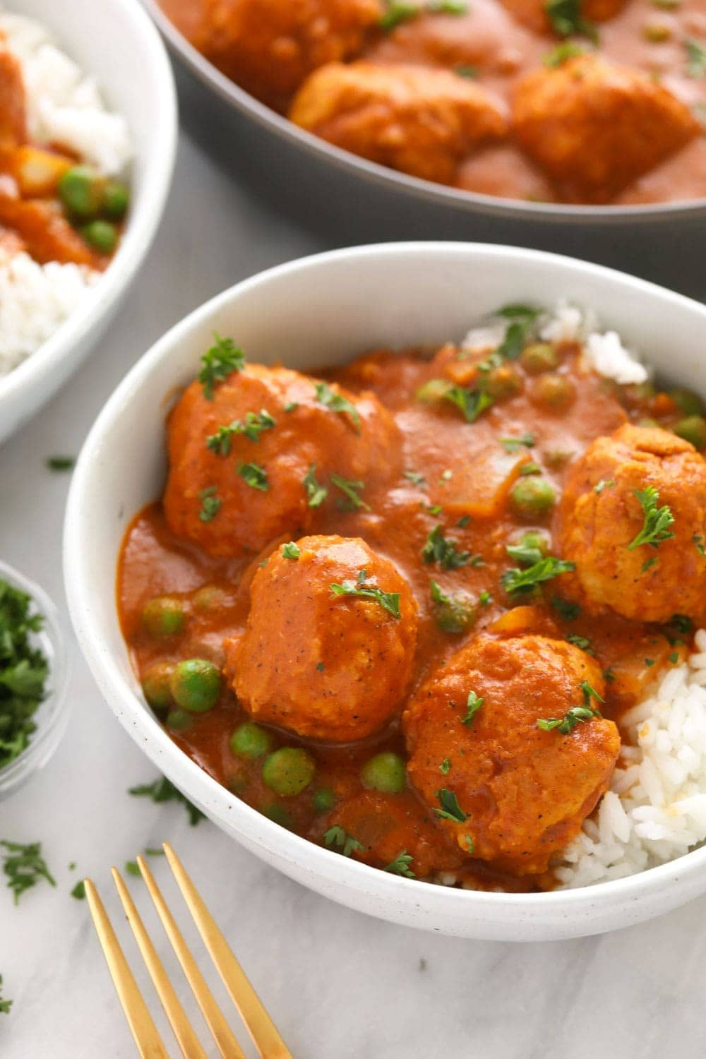 Tikka masala meatballs over rice