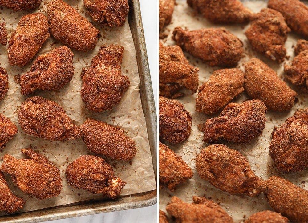 Dry rub wings on a baking sheet