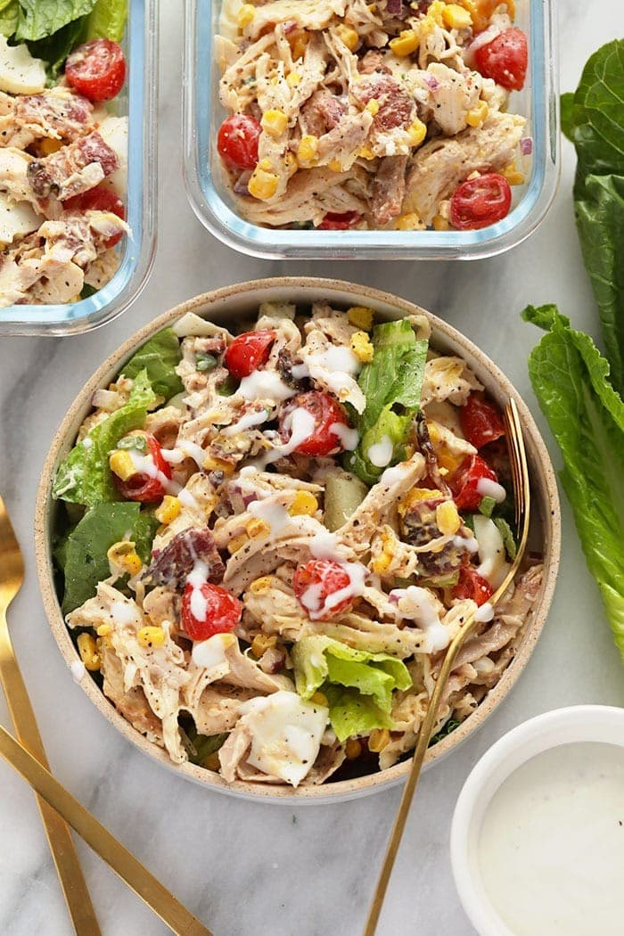 rotisserie chicken cob salad in a bowl ready to be eaten