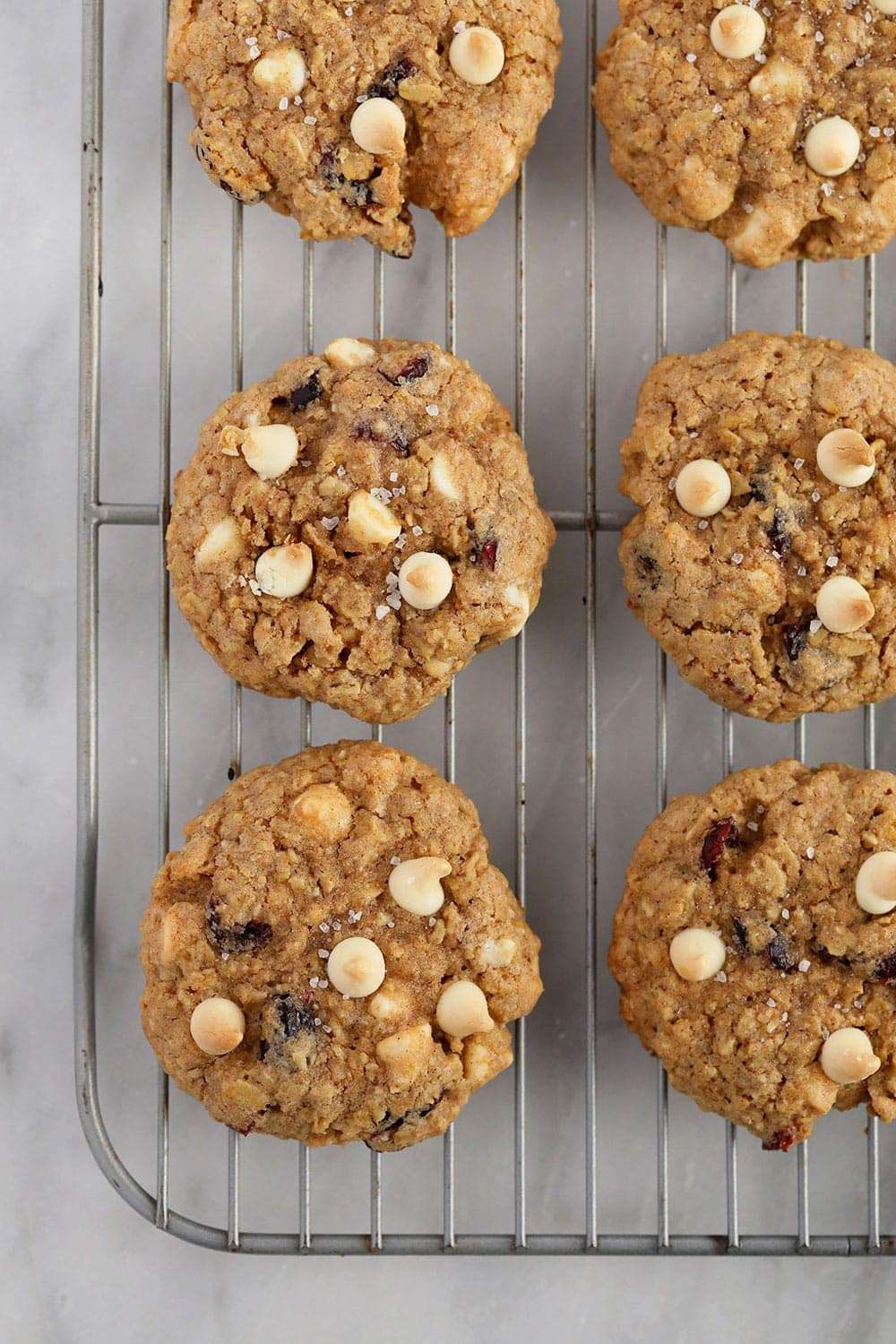 white chocolate cranberry oatmeal cookies on a cooling rack