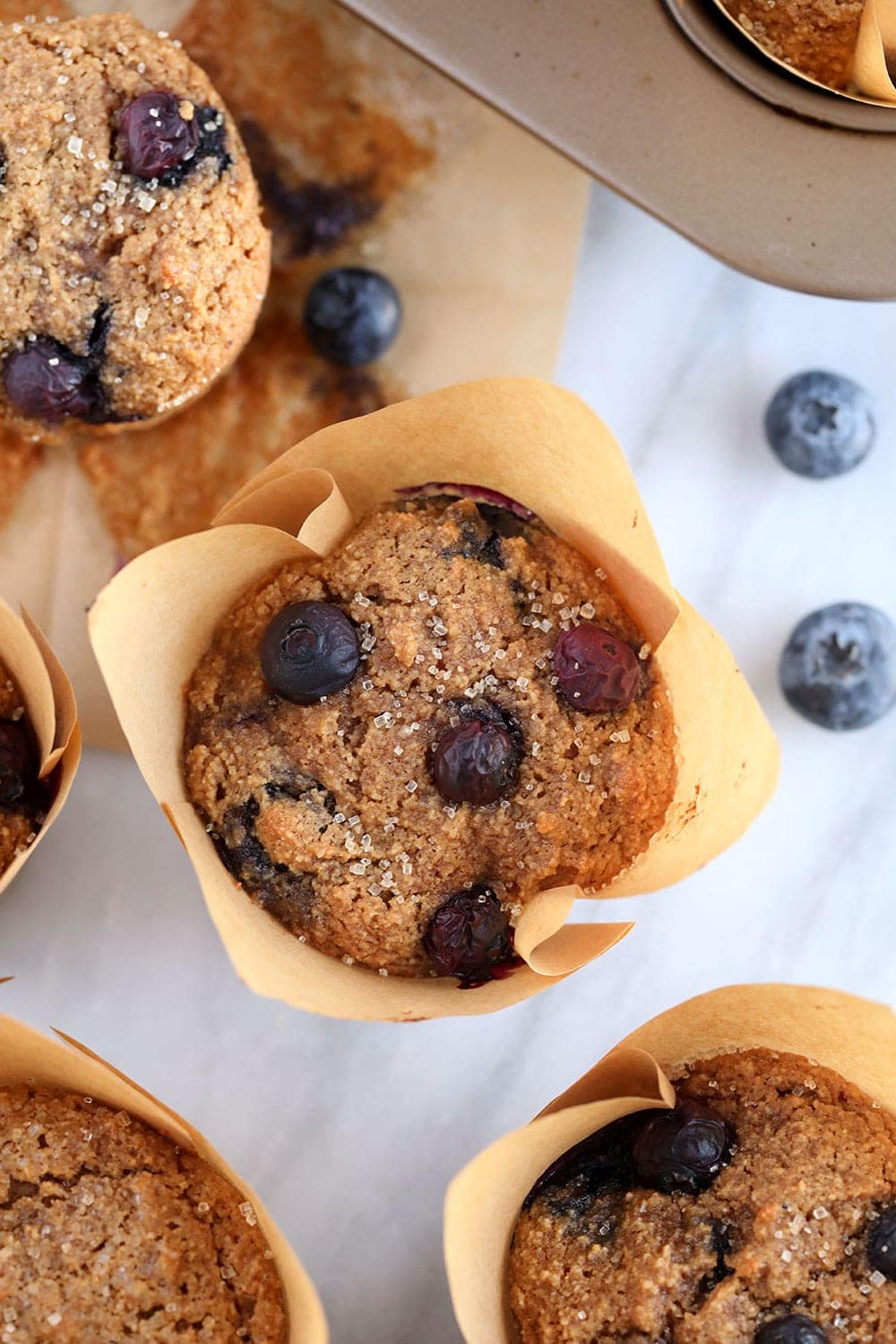 almond flour blueberry muffins in a muffin liner