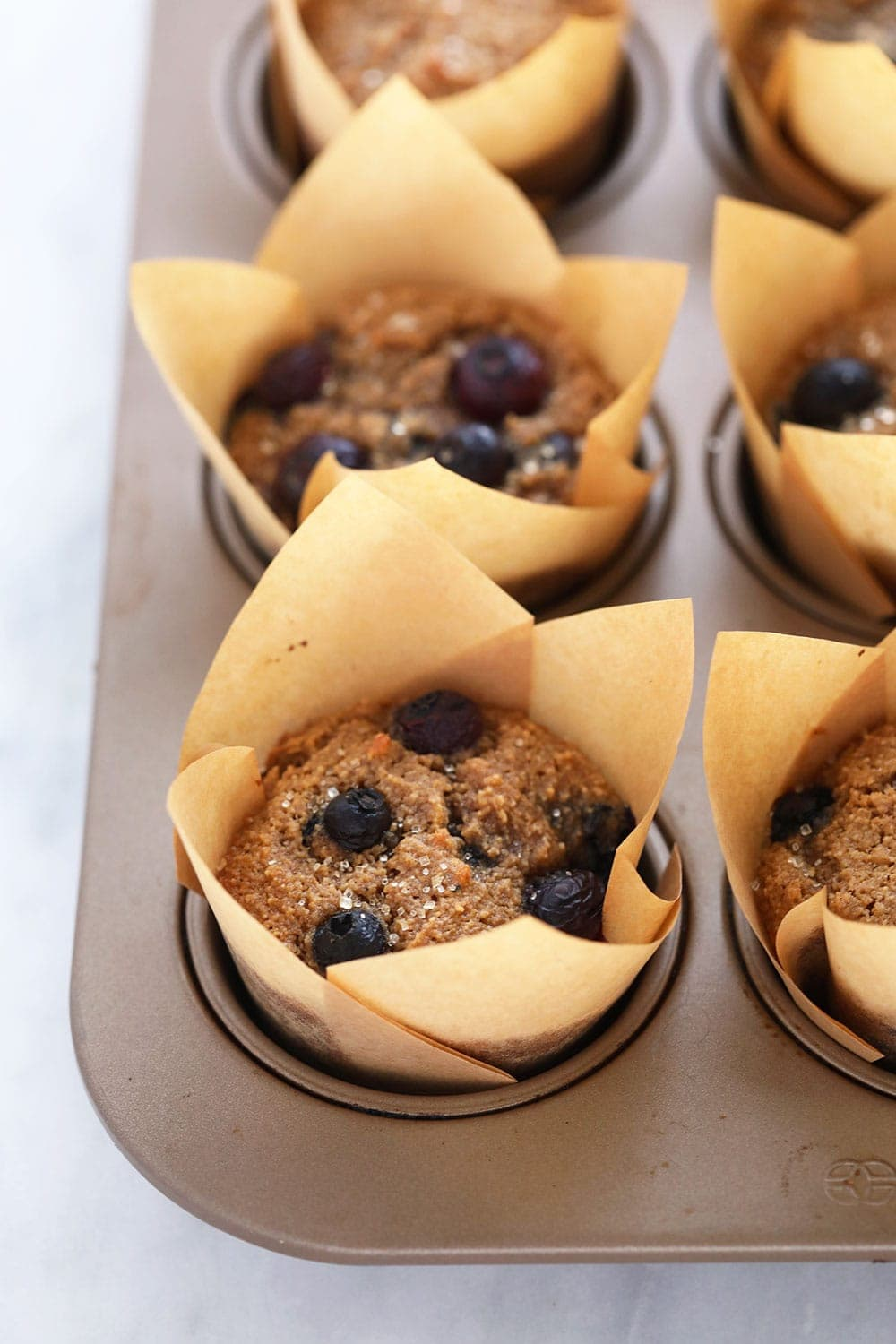 almond flour blueberry muffins in muffin liners after being baked