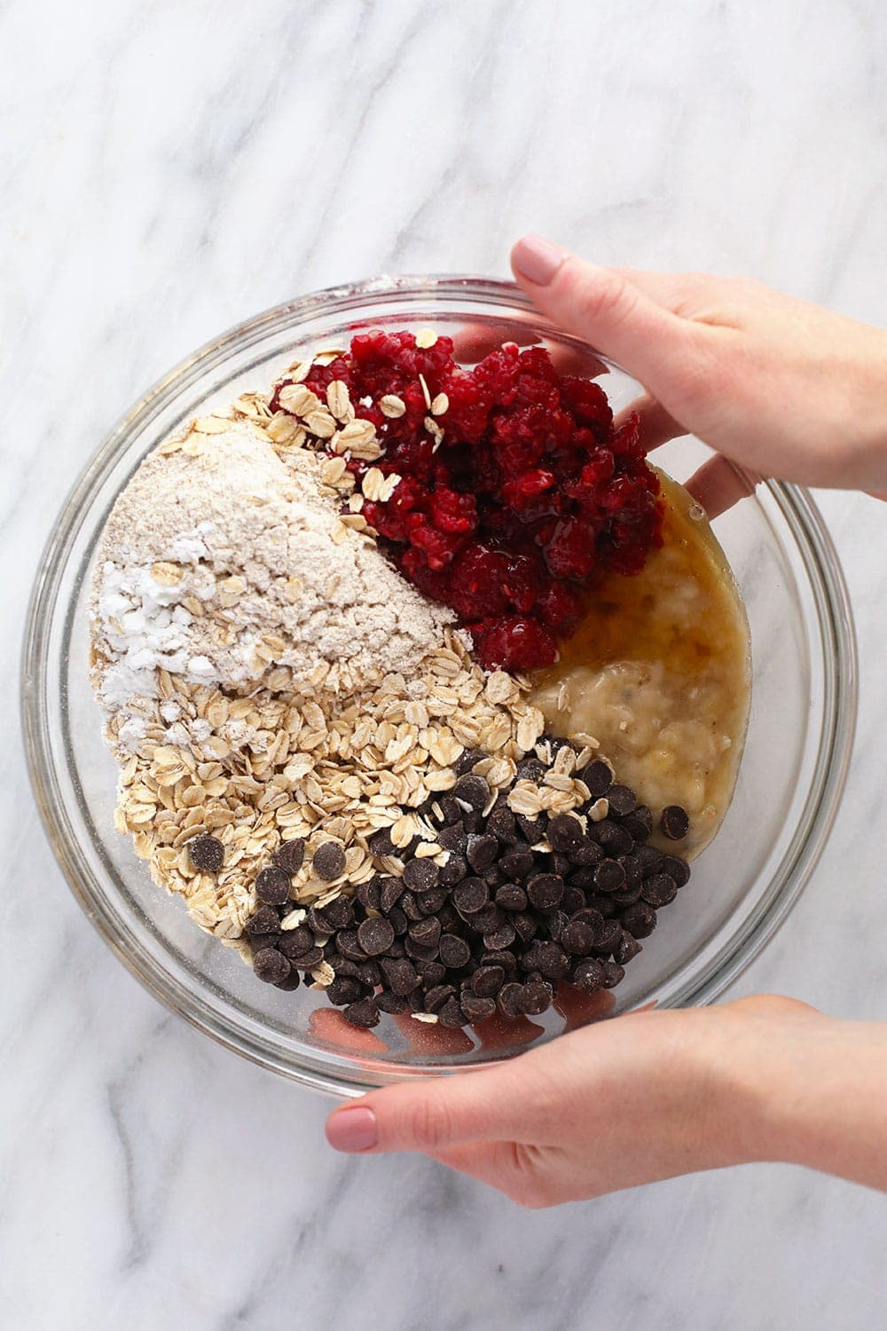 Raspberry baked oatmeal cups ingredients in bowl