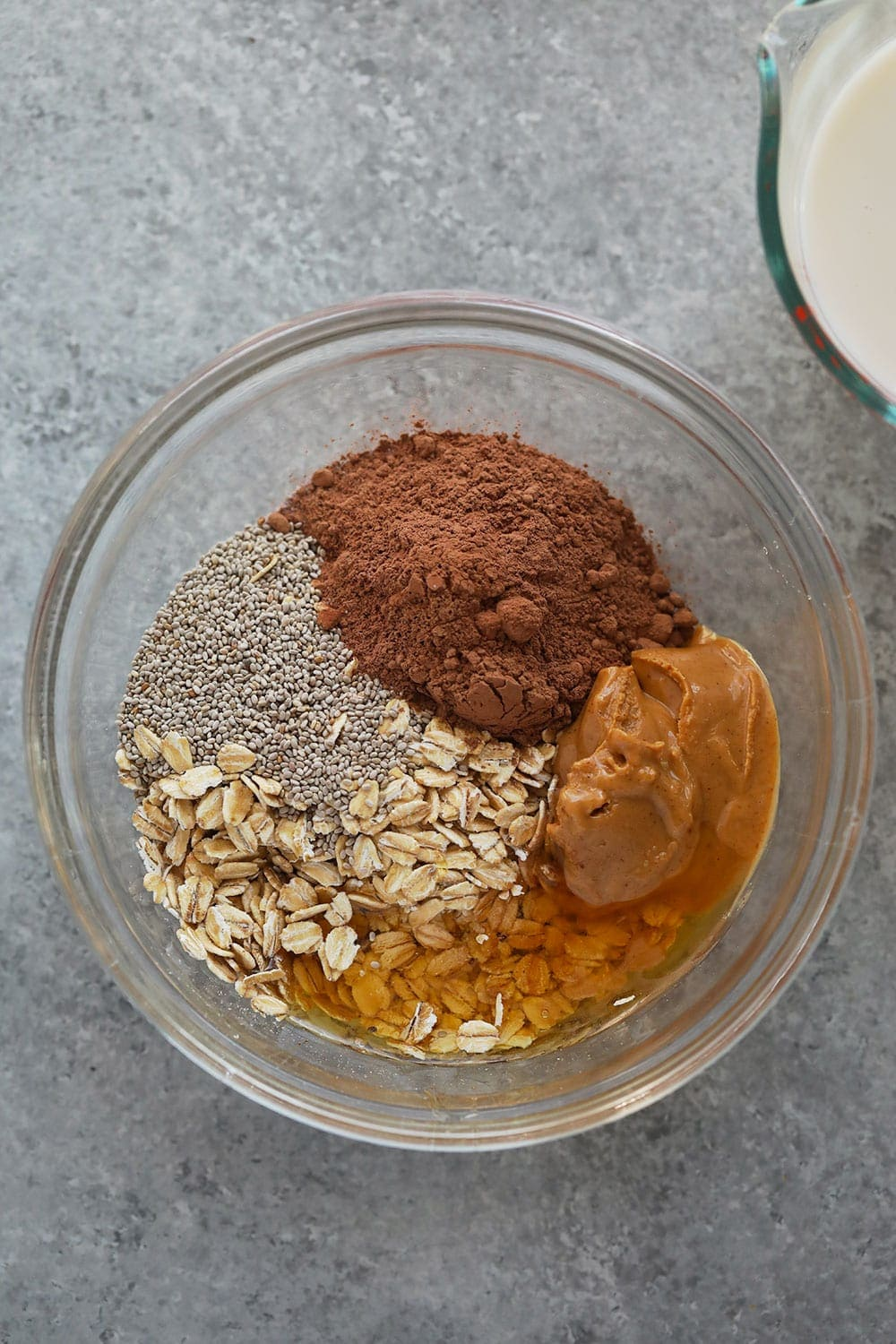 chocolate peanut butter overnight oats ingredients in a bowl