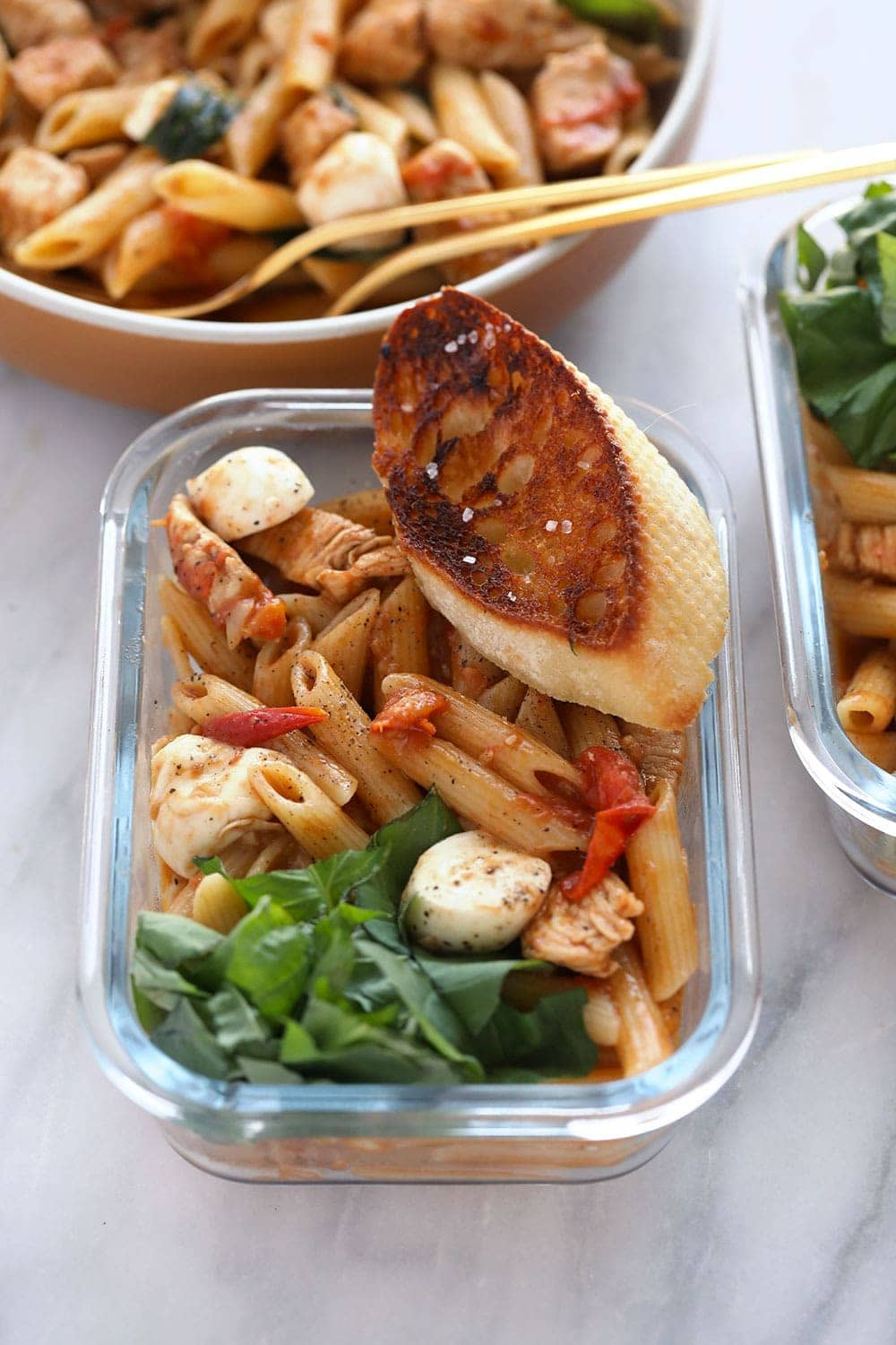 healthy caprese chicken pasta in a meal prep container