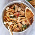 healthy caprese chicken pasta in a bowl