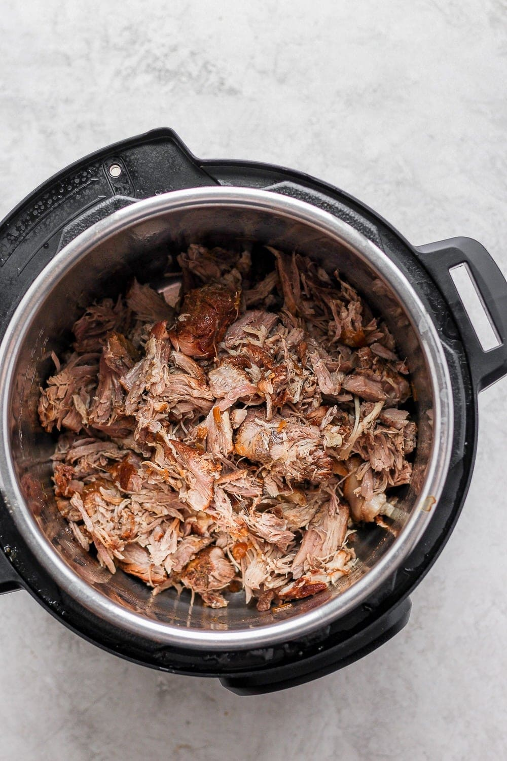 cooked shredded pulled pork in instant pot