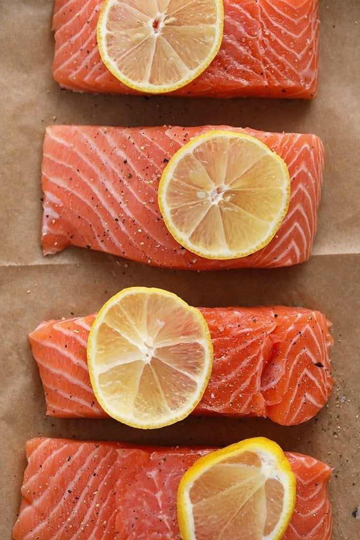salmon filets with lemon wedges