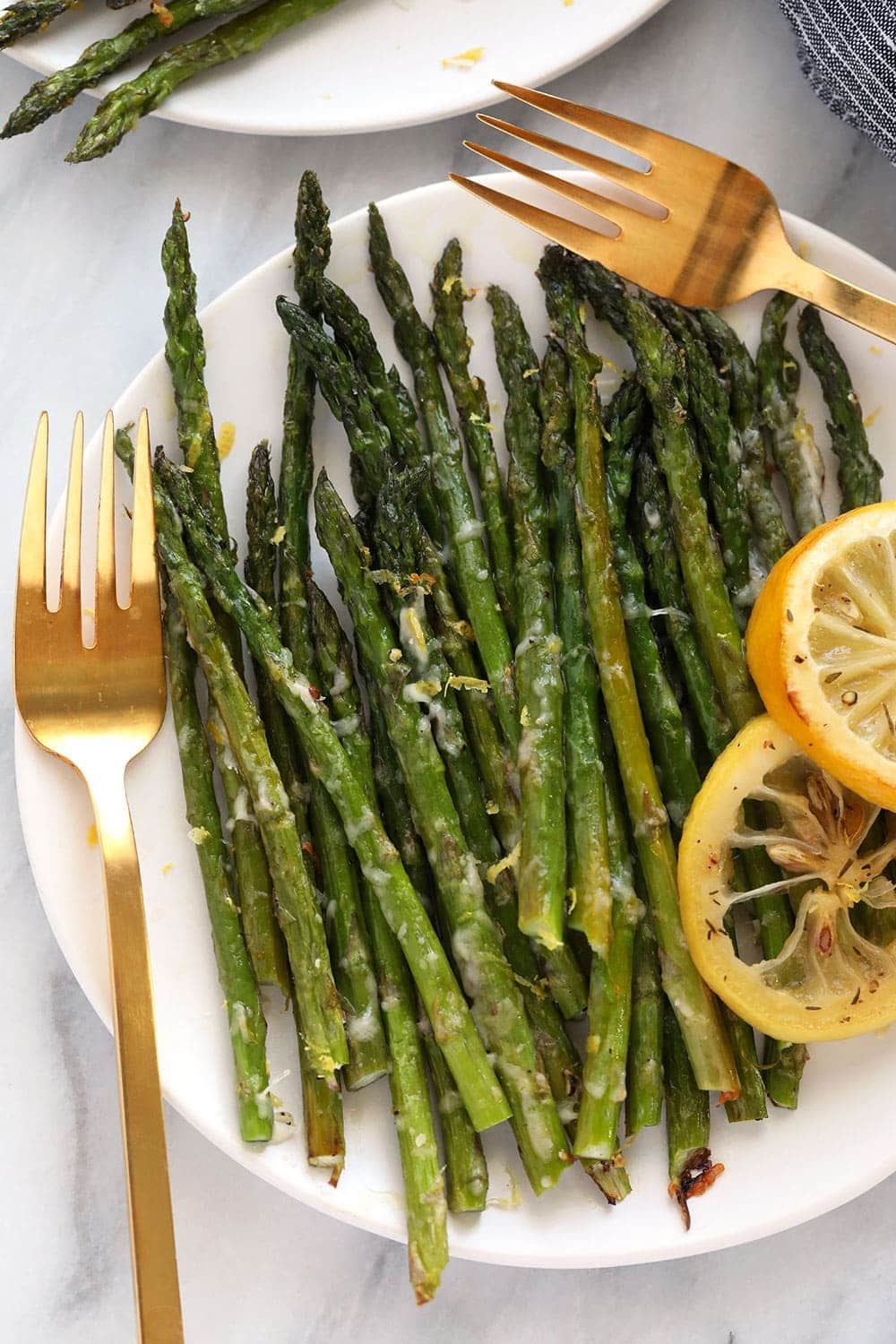 Oven roasted asparagus with parmesan cheese is the best way to eat asparagus! It's a healthy side dish recipe that's cooked to perfection.