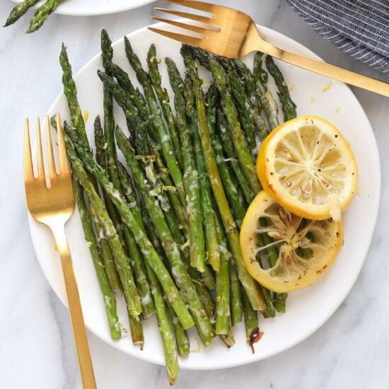 Asparagus on plate with lemon