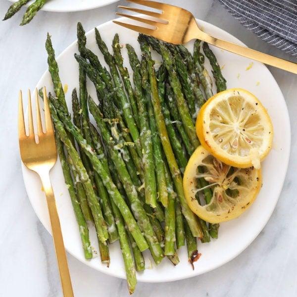 asparagus on plate with lemon